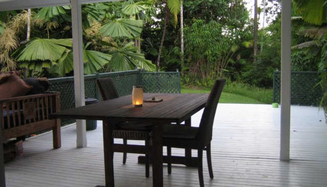 Tropical house in private rainforest beside water hole