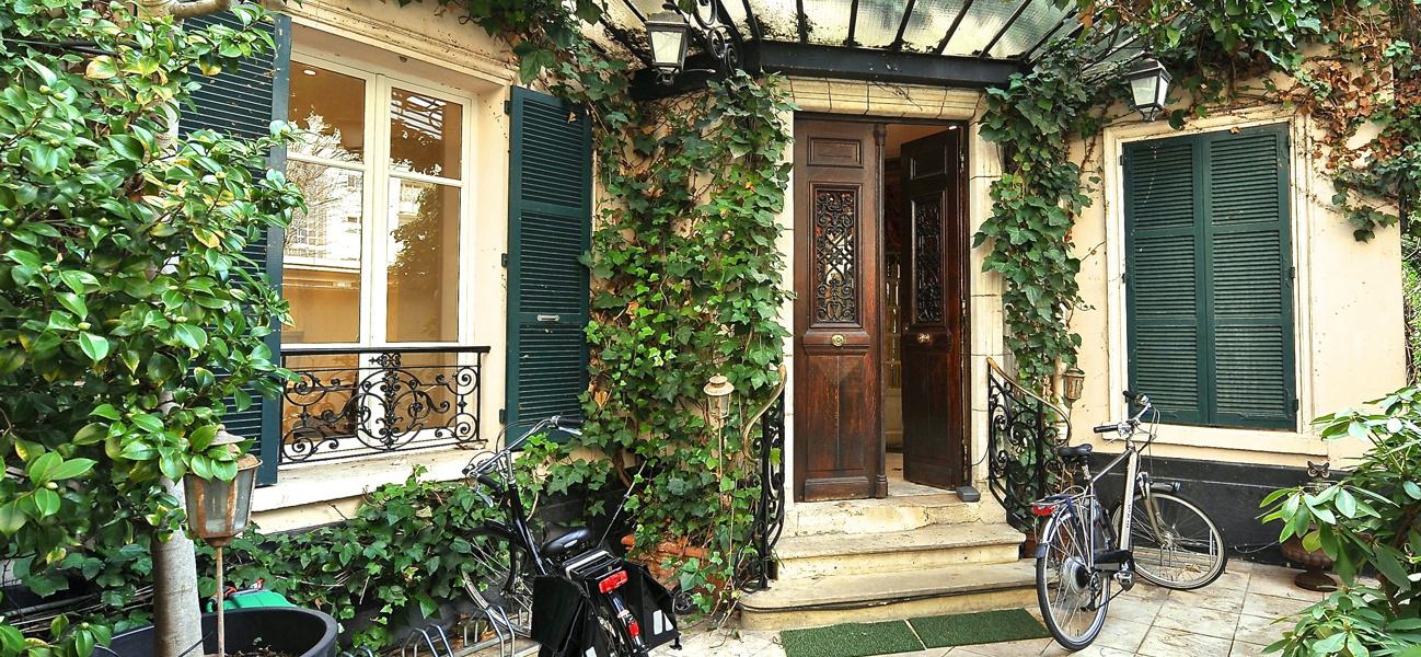 front door covered in ivy of home swap